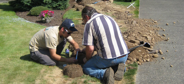 Fair Oaks CA sprinkler repair technicians bind joints for a new irrigation line