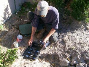 Irrigation repair technician in Citrus heights checks a valve box
